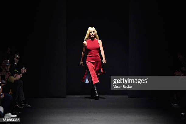 Designer Donatella Versace acknowledges the applause of the audience at the Versace show during Milan Men's Fashion Week Fall/Winter 2017/18 on...