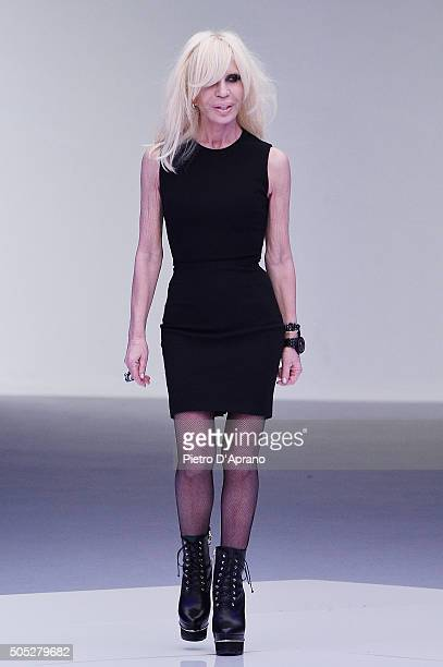 Designer Donatella Versace acknowledges the applause of the public after the Versace show during Milan Men's Fashion Week Fall/Winter 2016/17 on...