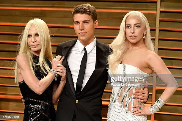 Designer Donatella Versace actor Nolan Gerard Funk and Musician Lady Gaga attend the 2014 Vanity Fair Oscar Party hosted by Graydon Carter on March 2...