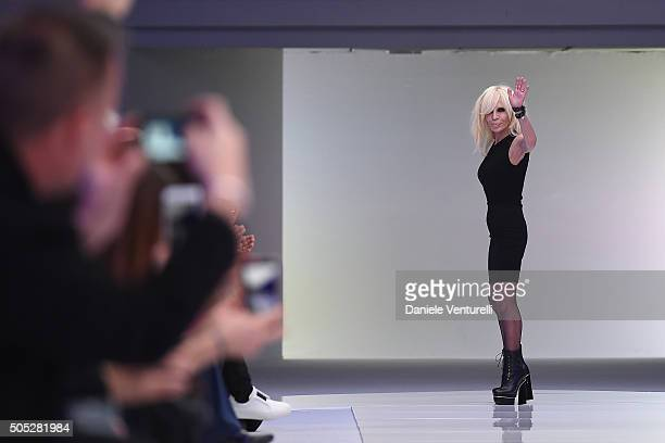 Designer Donatella Versace aknowledge the applause of the public after the Versace show during Milan Men's Fashion Week Fall/Winter 2016/17 on...