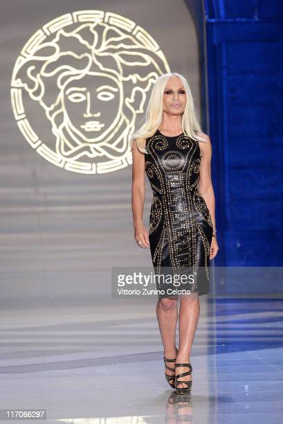 Designer Donatella Versace aknowledges the applause of the public after the Versace fashion show as part of Milan Fashion Week Menswear Spring/Summer...