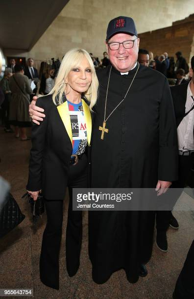 Designer Donatella Versace and Cardinal Timothy Michael Dolan attend the Heavenly Bodies Fashion The Catholic Imagination Costume Institute Gala...