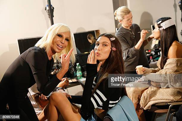 Designer Donatella Versace and model Bella Hadid are seen backstage ahead of the Versace show during Milan Fashion Week Spring/Summer 2017 on...
