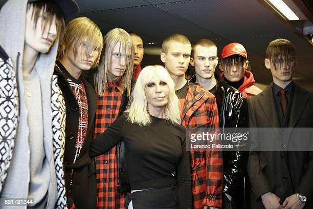 Designer Donatella Versace and models are seen backstage ahead of the Versace show during Milan Men's Fashion Week Fall/Winter 2017/18 on January 14...