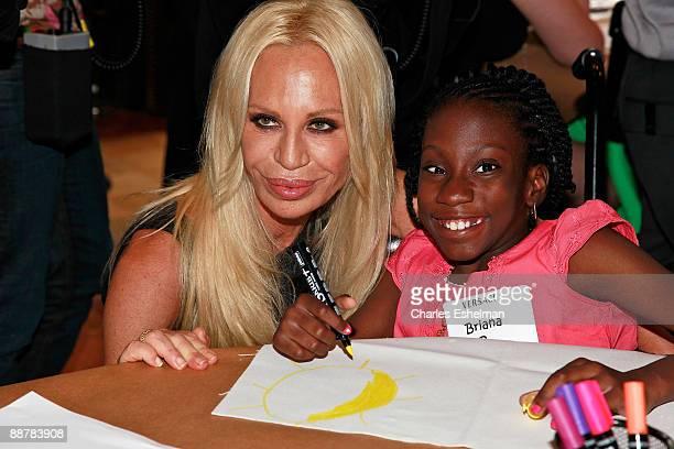 Designer Donatella Versace and Starlight Foundation children attend the Versace Whitney Art Party with the Starlight Foundation at The Whitney Museum...