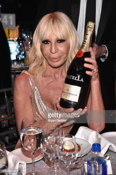 Designer Donatella Versace attends as Moet Chandon Toasts to the amfAR New York Gala At Cipriani Wall Street at Cipriani Wall Street on February 8...