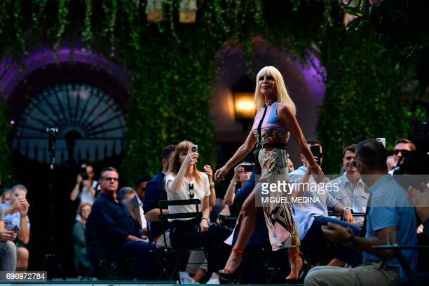 TOPSHOT Designer Donatella Versace greets the audience at the end of the show for fashion house Versace during the Men's Spring/Summer 2018 fashion...