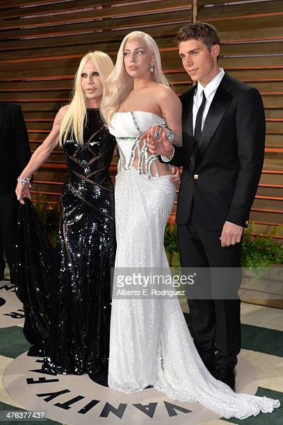 Designer Donatella Versace musician Lady Gaga and actor Nolan Gerard Funk attend the 2014 Vanity Fair Oscar Party hosted by Graydon Carter on March 2...