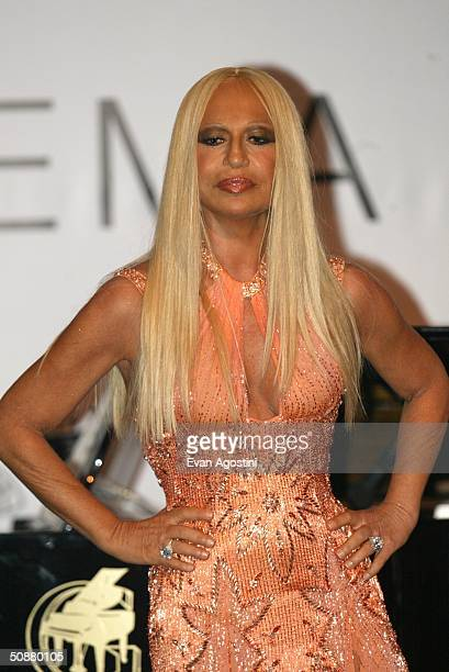 """Designer Donatella Versace speaks on stage the auction at """"Cinema Against AIDS 2004"""", the 11th annual event in aid of amfAR at Le Moulin de Mougins..."""