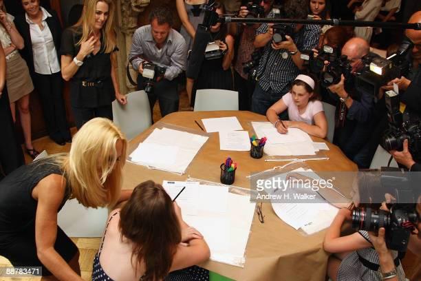 Designer Donatella Versace visits with Starlight Foundation children at the Versace Whitney Art Party with the Starlight Foundation at The Whitney...