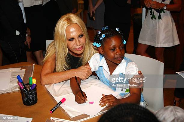 Designer Donatella Versace visits with Starlight Foundation children at the Versace Whitney Art Party with the Starlight Foundation at The Whitney...