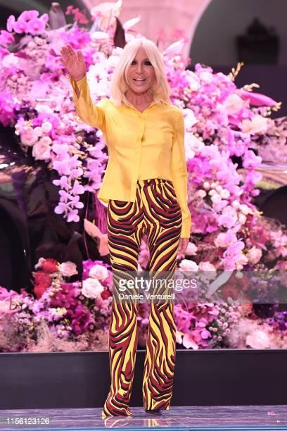 Designer Donatella Versace walks the runway at the Versace fashion show during the Milan Men's Fashion Week Spring/Summer 2020 on June 15, 2019 in...