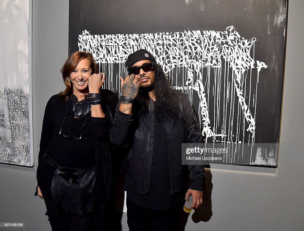 Designer Donna Karan (L) and artist Ashish 'Hash' Patel attend Art For Social Justice, Usher Raymond IV, Daniel Arhsam and TIDAL debut Chains at Urban Zen on January 29, 2016 in New York City.