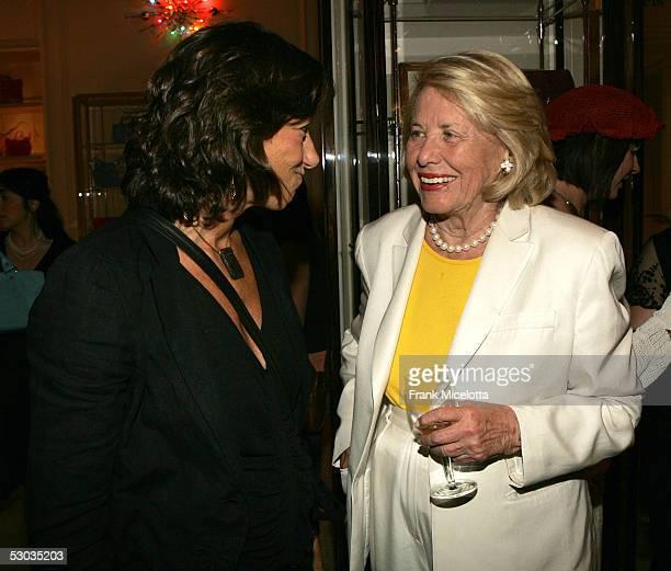 Designer Donna Karan and gossip columnist Liz Smith chat at a party in celebration of Madonna's latest children's book Lotsa De Casha at Bergdorf...