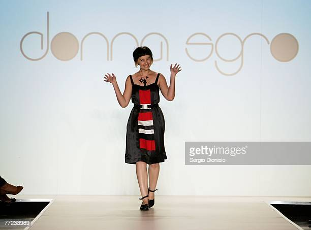 Designer Donna Sgro of the label Donna Sgro acknowledges the audience following her catwalk collection show as part of the New Generation Catwalk...