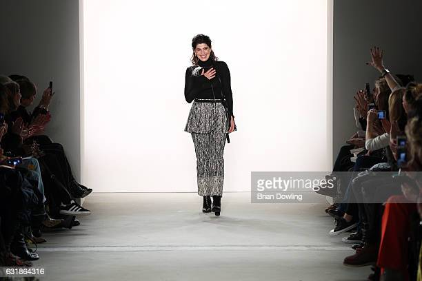 Designer Dorothee Schumacher acknowledges the applause of the audience after her show during the MercedesBenz Fashion Week Berlin A/W 2017 at...
