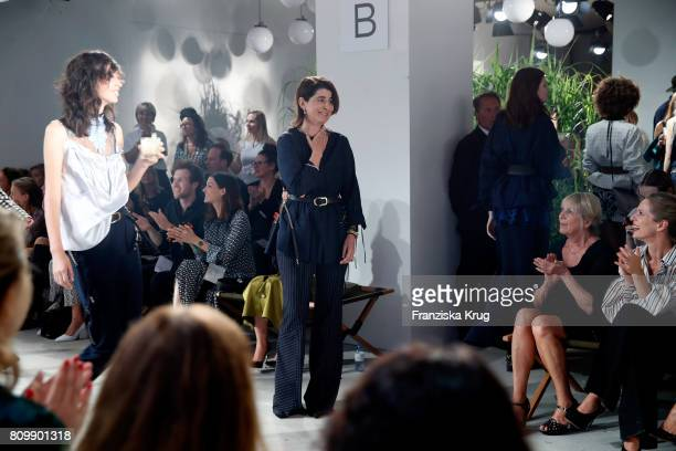 Designer Dorothee Schumacher acknowledges the applause of the audience after her show during the MercedesBenz Fashion Week Berlin Spring/Summer 2018...