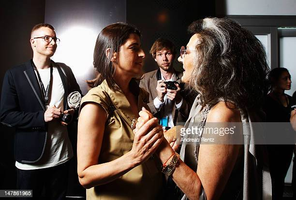 Designer Dorothee Schumacher and Angelica Blechschmidt talk to each other backstage prior to the Schumacher show at MercedesBenz Fashion Week...