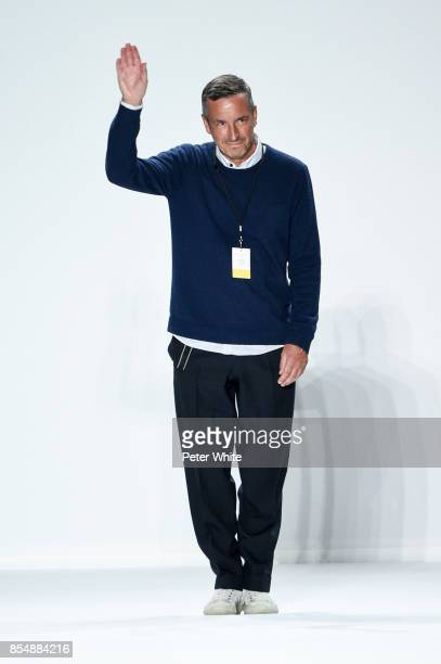 Designer Dries Van Noten acknowledges the audience at the end of his show as part of the Paris Fashion Week Womenswear Spring/Summer 2018 on...