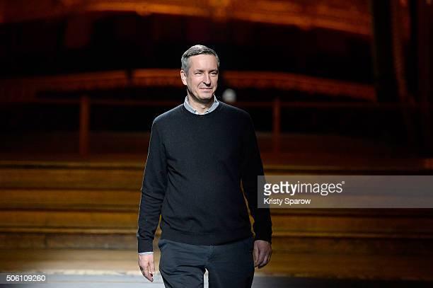 Designer Dries Van Noten acknowledges the audience during the Dries Van Noten Menswear Fall/Winter 20162017 show as part of Paris Fashion Week on...