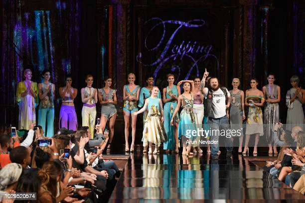 Designer Duane Topping and Model Madeline Stuart walk the runway during the TOPPING DESIGN show at New York Fashion Week Powered By Art Hearts...