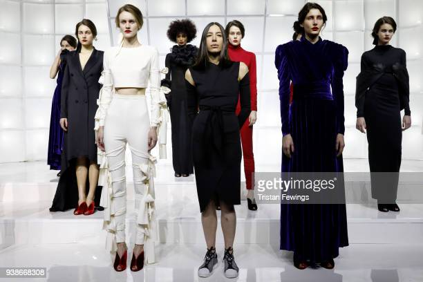 Designer Ece Kavran poses with models at the Urun show during MercedesBenz Istanbul Fashion Week at the Zorlu Performance Hall on March 27 2018 in...