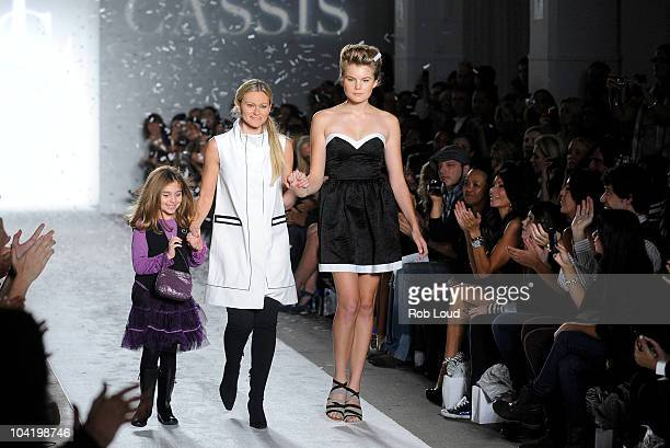 Designer Elene Cassie and Christine Staub walk the runway as Danielle Staub Rachelle Hruska and Lori Michaels watch on at the Elene Cassis Spring...