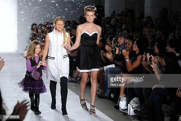 Designer Elene Cassie and Christine Staub walk the runway as Danielle Staub Rachelle Hruska and Lori Michaels watch on at the Elene Cassis Spring...