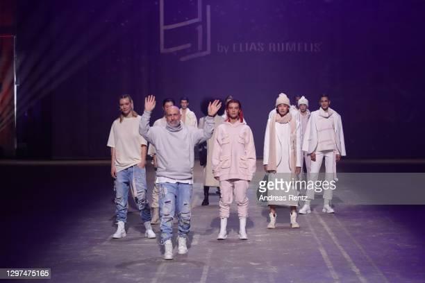 Designer Elias Rumelis walks the runway after his show, Eli by Elias Rumelis, during the Mercedes-Benz Fashion Week Berlin January 2021 at Kraftwerk...