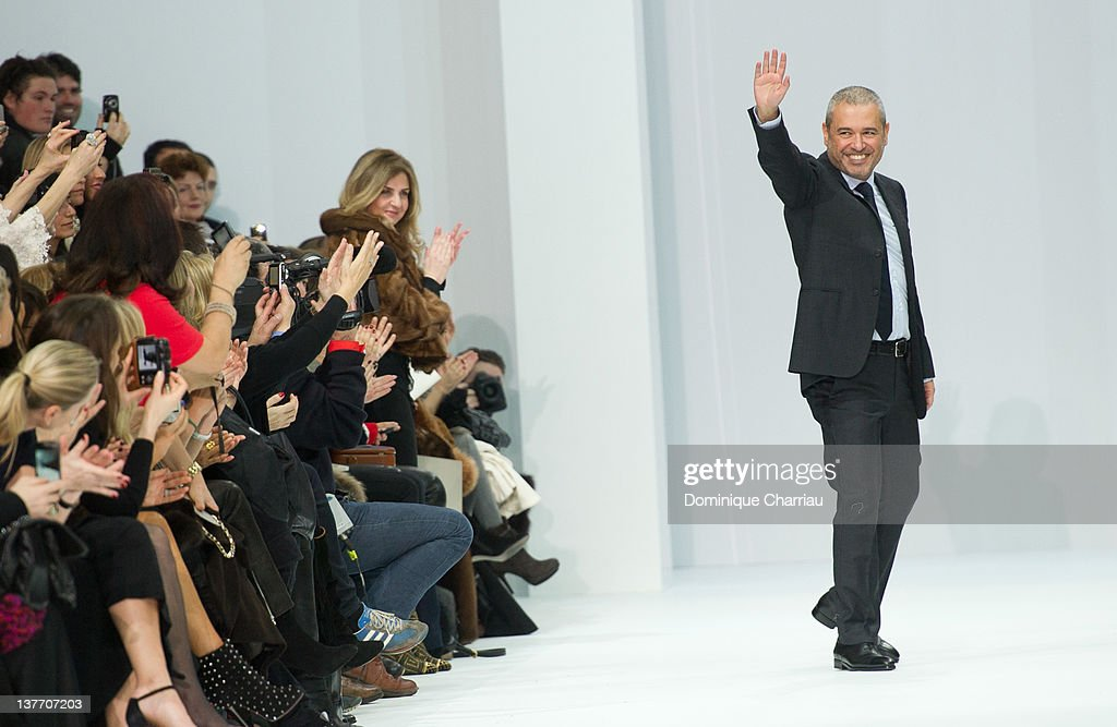 Designer Elie Saab acknowledges the applause of the audience after the Elie Saab Spring/Summer 2012 Haute-Couture Show as part of Paris Fashion Week at Grand Palais on January 25, 2012 in Paris, France.