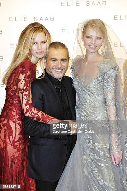 Designer Elie Saab poses with his Models at the end of the Elie Saab show as part of Paris Fashion Week Fall/ Winter 2011 at Palais de Chaillot in...