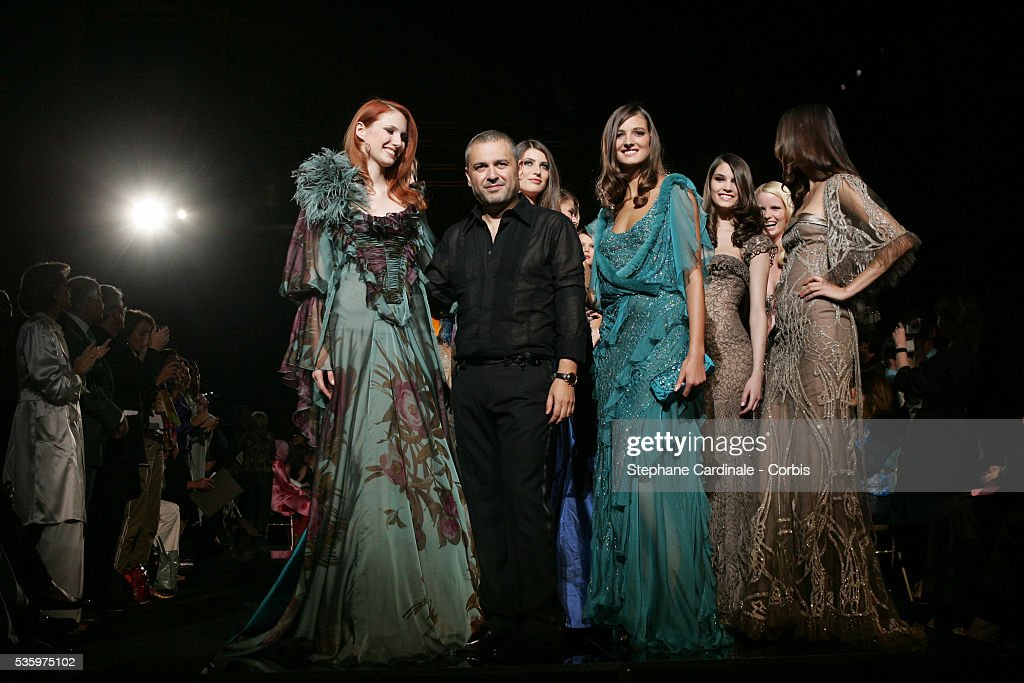Designer Elie Saab takes the catwalk at the end of his Fall/Winter 2005-2006 'Haute Couture' fashion collection..