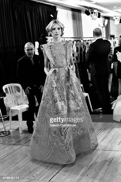 Designer Elie Saab works backstage before his show as part of Paris Fashion Week Haute Couture Fall/Winter 2015/2016 on July 8 2015 in Paris France
