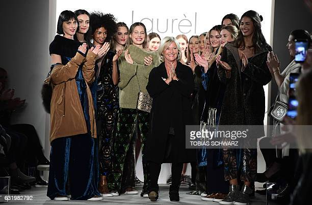 Designer Elisabeth Schwaiger poses with models after the show by Laurel at the Berlin Fashion Week in Berlin on January 18 2017 / AFP / Tobias SCHWARZ
