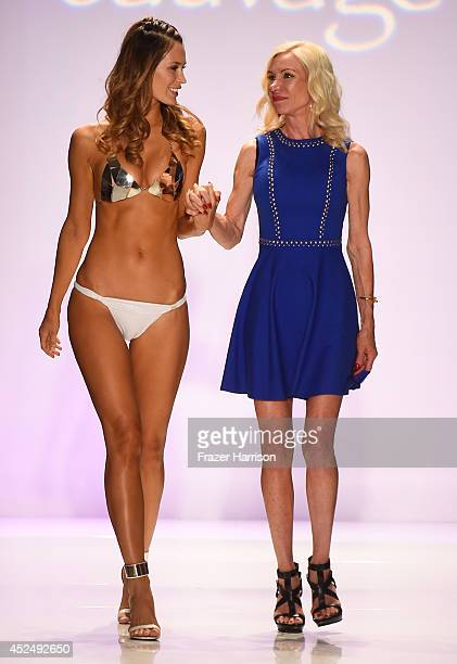 Designer Elizabeth Southwood of Sauvage and a model walk the runway at the Sauvage/Aguaclara Swimwear/Aquarella Swimwear/Mia Marcelle/Toxic Sadie...