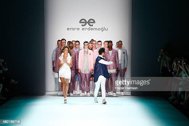Designer Emre Erdemoglu and a model walk the runway after his show during the MercedesBenz Fashion Week Berlin Spring/Summer 2016 at Brandenburg Gate...