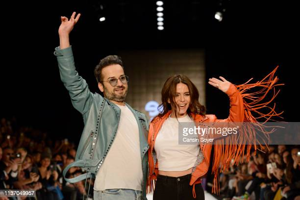 Designer Emre Erdemoglu and singer Simge acknowledge the applause of the audience after the Emre Erdemoglu show during MercedesBenz Istanbul Fashion...