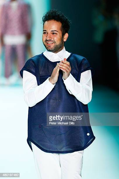 Designer Emre Erdemoglu walks the runway after his show during the MercedesBenz Fashion Week Berlin Spring/Summer 2016 at Brandenburg Gate on July 10...