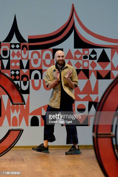 Designer Emre Pakel walks the runway after hi show as part of MercedesBenz Istanbul Fashion Week at the Zorlu Performance Hall on March 19 2019 in...