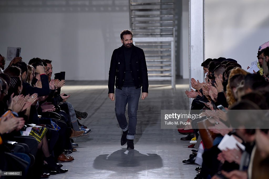 Designer Ennio Capasa walks the runway after the Costume National Show as a part of Milan Menswear Fashion Week Fall Winter 2015/2016 on January 17, 2015 in Milan, Italy.