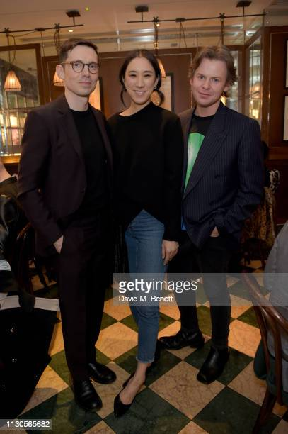 Designer Erdem Moralioglu Eva Chen and designer Christopher Kane attend the official Erdem London Fashion Week dinner at J Sheekey Atlantic Bar on...