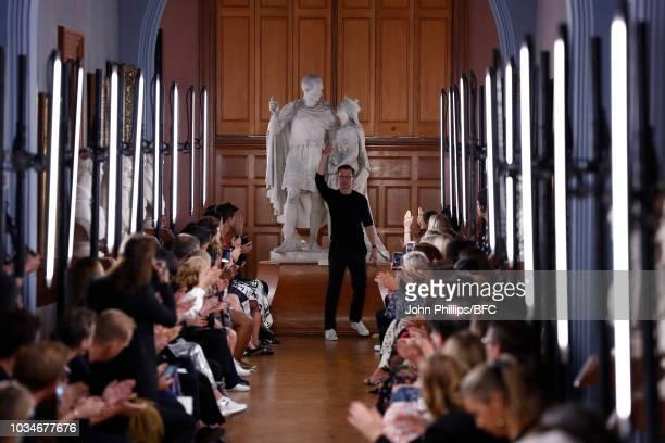 Designer Erdem Moralioglu walks the runway during the finale of his ERDEM show during London Fashion Week September 2018 on September 17 2018 in...
