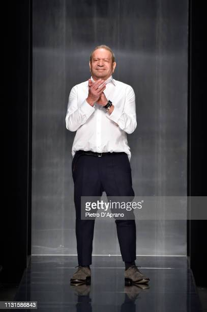 Designer Ermanno Scervino acknowledges the applause of the audience after his show at Milan Fashion Week Autumn/Winter 2019/20 on February 23 2019 in...