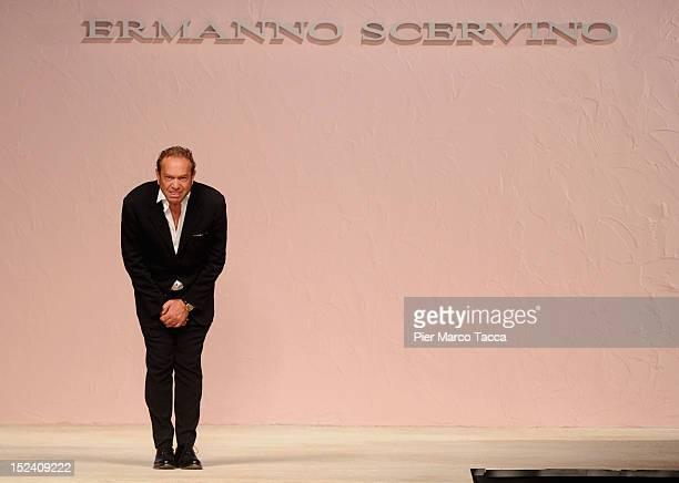 Designer Ermanno Scervino acknowledges the applause of the audience after the Ermanno Scervino Spring/Summer 2013 fashion show as part of Milan...