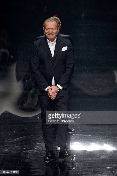 Designer Ermanno Scervino acknowledges the applause of the audience after the Ermanno Scervino show during the Milan Fashion Week Autumn/Winter 2015...