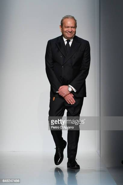 Designer Ermanno Scervino acknowledges the applause of the public after the runway at the Ermanno Scervino show during Milan Fashion Week Fall/Winter...
