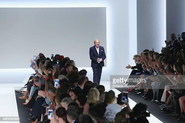 Designer Ermanno Scervino acknowledges the audience at the end of the Ermanno Scervino fashion show as part of Milan Fashion Week Spring/Summer 2016...