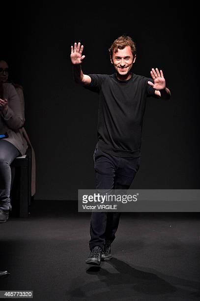 Designer Esteban Cortazar walks the runway during the Esteban Cortazar show as part of the Paris Fashion Week Womenswear Fall/Winter 2015/2016 on...