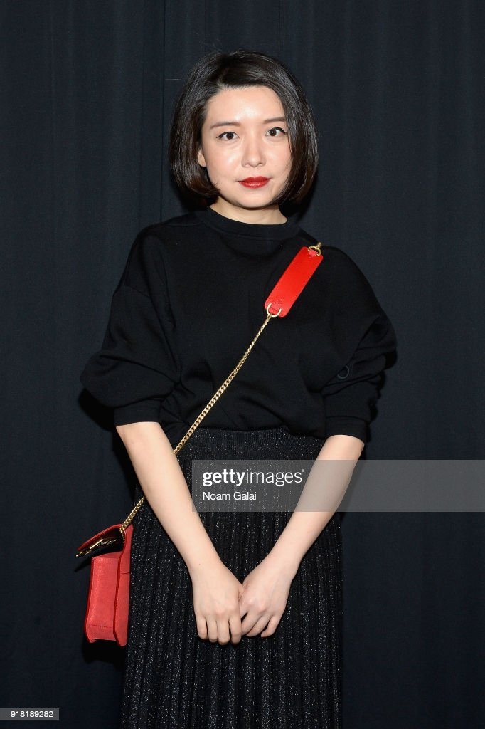 Designer Eva Xu poses backstage for the All Comes From Nothing x COOME FW18 show at Gallery II at Spring Studios on February 14, 2018 in New York City.