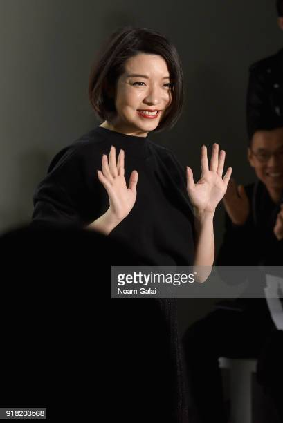 Designer Eva Xu poses backstage for the All Comes From Nothing x COOME FW18 show at Gallery II at Spring Studios on February 14 2018 in New York City